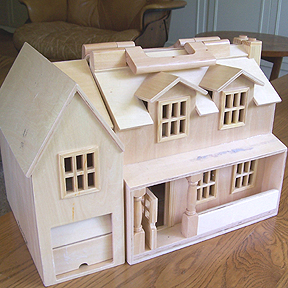 小型的娃娃屋。Example of a wooden dollhouse.
