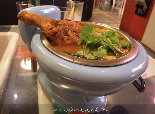 My tom yum ramen with chicken drumstick served in a toilet bowl!