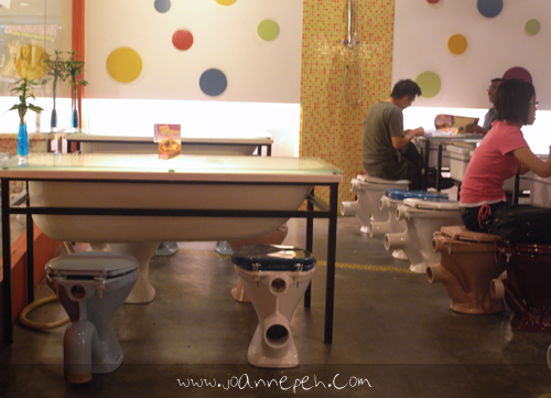 "This cafe is very interesting because it's a ""toilet"" concept. Toilet bowls are used as seats, bathtubs with a glass surface as tables, and wait till you see the food!"